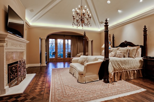 Bedroom with fireplace and chandelier Home Loan bond originator specialist bank home loans best interest rate